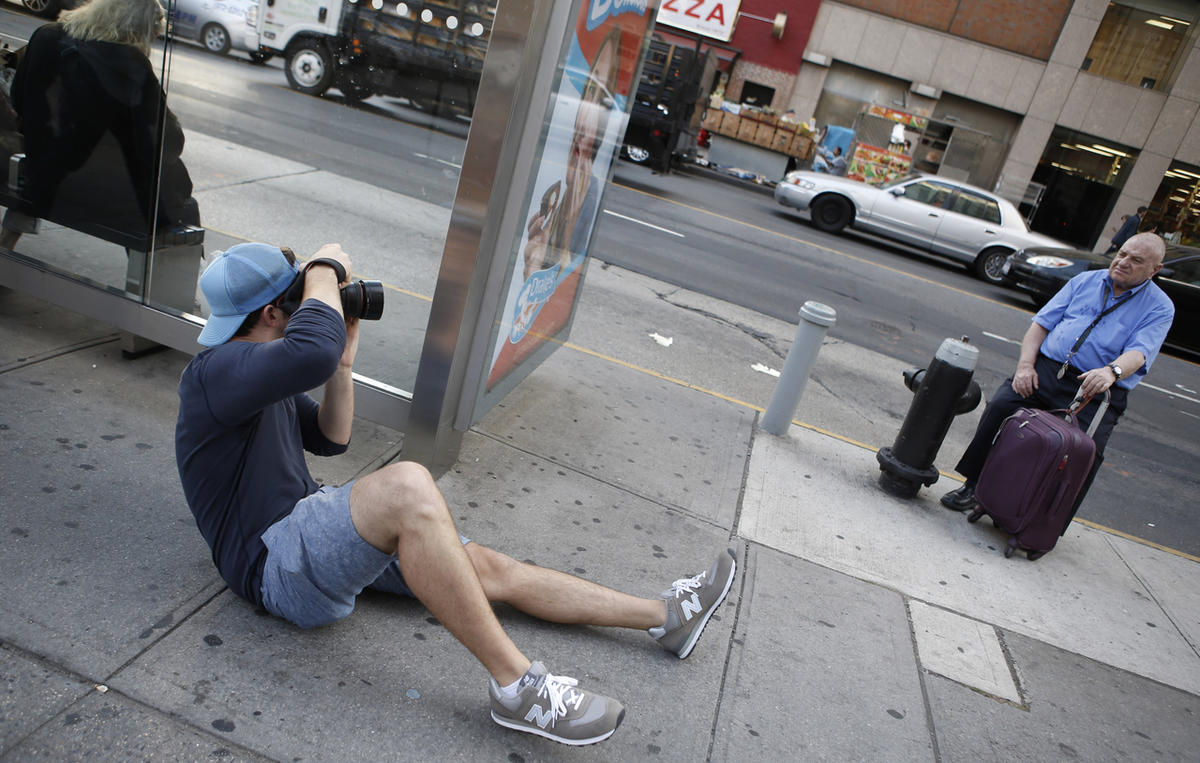 Brandon Stanton in action on October 2, 2013, taking a photo of a man in New York.