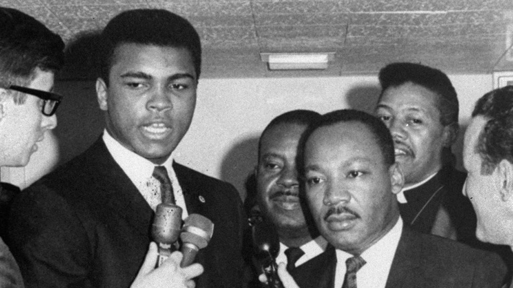 Muhammad Ali with Dr. Martin Luther King Jr., getting interviewed